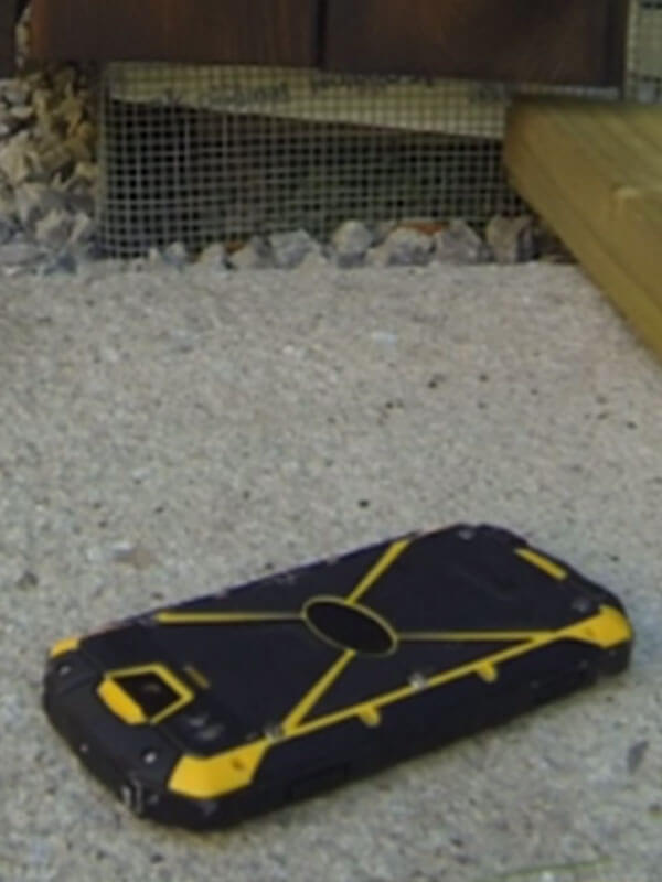 Rugged device undergoing sandproof test